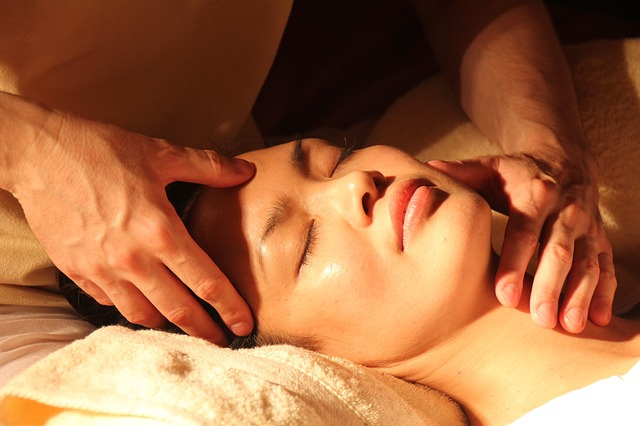 man and woman relaxing on massage tables